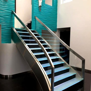 Stainless Staircase with bent glass and LED backlit glass steps
