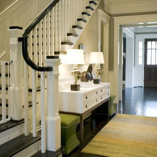 Entryway - traditional dark wood floor and black floor entryway idea in Atlanta with beige walls