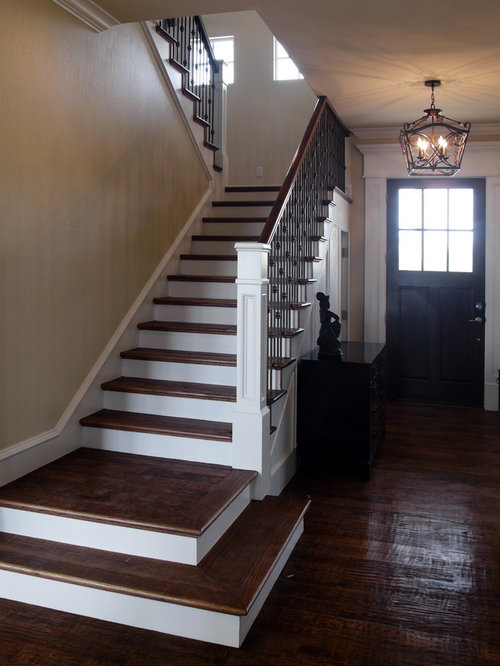 Foyer Stairs Reviews : Carved newel posts on split finish stair entryway design