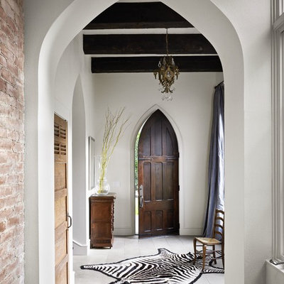 Eclectic white floor entryway photo in Austin with white walls and a dark wood front door