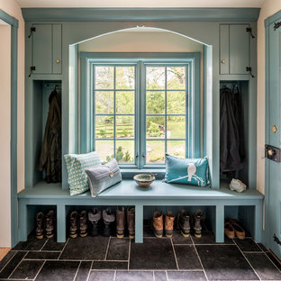 Entryway - large traditional black floor entryway idea in Philadelphia with a blue front door