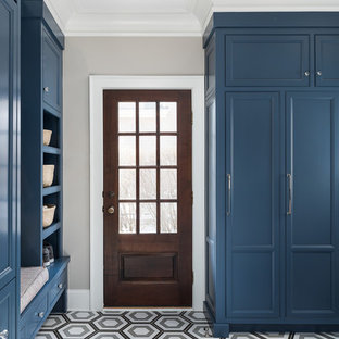 Transitional multicolored floor entryway photo in Chicago with gray walls and a dark wood front door