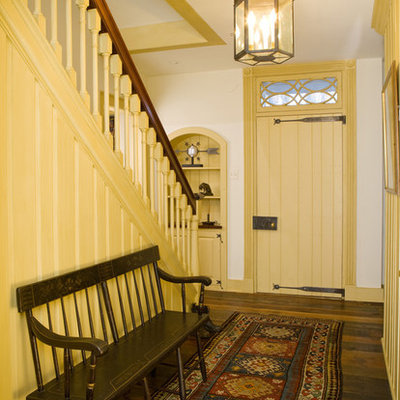 Mid-sized cottage medium tone wood floor entryway photo in Philadelphia with white walls and a yellow front door