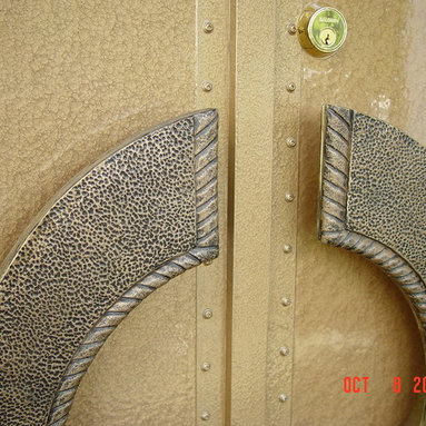 Steel Entrance Doors by Arttig - 6 f. x 8 f. Ornamental Iron design doors with custom sculpted and cast in bronze inserts.
