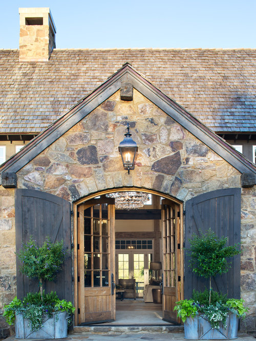 Inspiration For A Farmhouse Entryway Remodel In Denver With Brown Walls Limestone Floors A