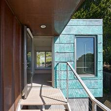 Modern Porch by WNUK SPURLOCK Architecture