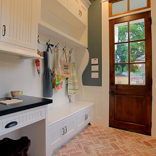 Inspiration for a mid-sized timeless brick floor entryway remodel in Houston with green walls and a dark wood front door