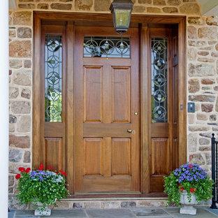 Design ideas for a country front door in Philadelphia with a single front door and a medium wood front door.