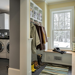 Inspiration for a mid-sized timeless slate floor mudroom remodel in Portland Maine with yellow walls