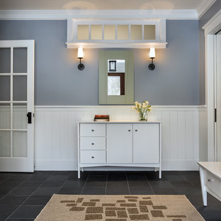 Inspiration for a large timeless slate floor entryway remodel in Portland Maine with gray walls and a medium wood front door