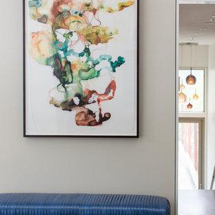 Mid-sized minimalist medium tone wood floor entryway photo in San Francisco with gray walls and a medium wood front door