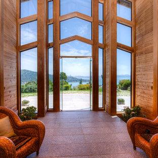 サンフランシスコの巨大な両開きドアエクレクティックスタイルのおしゃれな玄関ロビー (ガラスドア) の写真