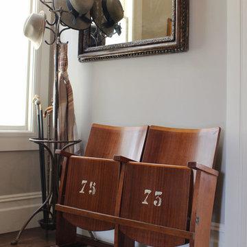 Stylish entry with vintage Italian cinema seats
