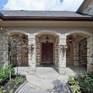 Trendy double front door photo in Houston with a dark wood front door