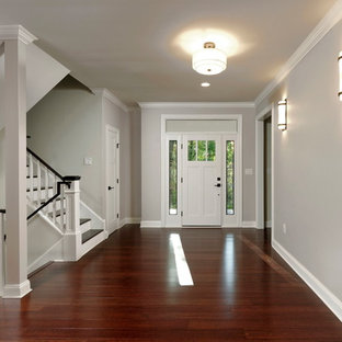 Inspiration for a mid-sized craftsman bamboo floor and brown floor entryway remodel in DC Metro with gray walls and a white front door