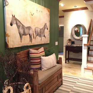 Mountain style travertine floor, beige floor and wall paneling entryway photo in Other