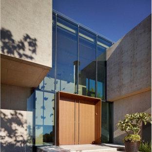 На фото: класса люкс большие входные двери в стиле модернизм с серыми стенами, мраморным полом, двустворчатой входной дверью, входной дверью из дерева среднего тона и бежевым полом