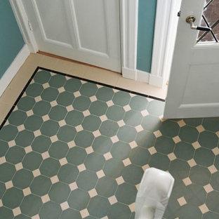 Inspiration för en vintage foajé, med klinkergolv i porslin, en enkeldörr, en vit dörr, gröna väggar och grönt golv