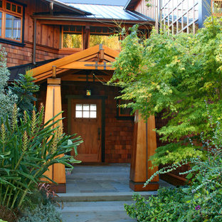 Arts and crafts entryway photo in Seattle with a medium wood front door