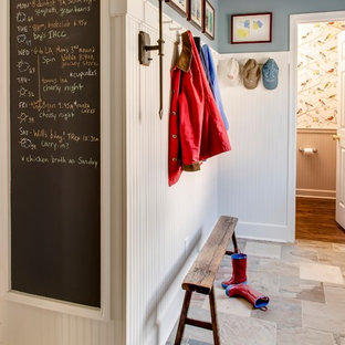 Inspiration for a timeless mudroom remodel in Kansas City with white walls