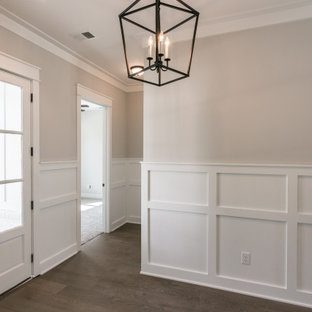Entryway - mid-sized cottage vinyl floor and brown floor entryway idea in Nashville with gray walls and a glass front door