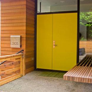 Entryway - contemporary entryway idea in Portland with a yellow front door