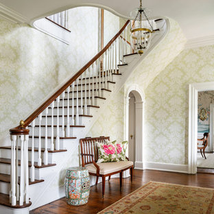 Inspiration for a timeless medium tone wood floor and brown floor foyer remodel in Other with multicolored walls