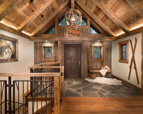 Timber post and beam mountain ranch home entryway design for Ranch home entryway design ideas