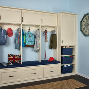 Mudroom - mid-sized transitional dark wood floor mudroom idea in Orange County with blue walls