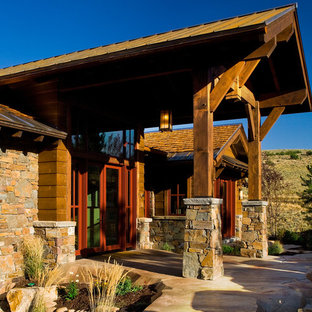 Example of a mountain style double front door design in Salt Lake City with a glass front door