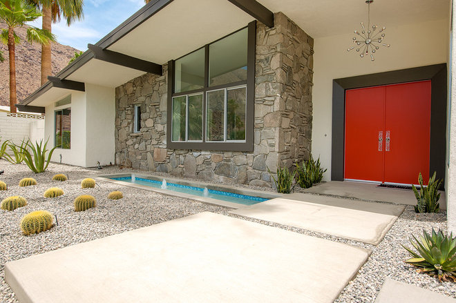 Midcentury Exterior by H3K Design