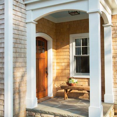 Single front door - traditional light wood floor single front door idea in Boston