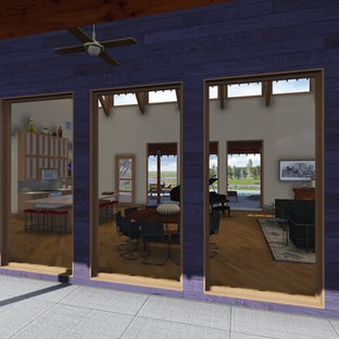 Mid-sized southwest concrete floor entryway photo in Houston with purple walls and a light wood front door