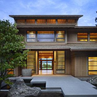 Стильный дизайн: входная дверь в восточном стиле с бетонным полом и двустворчатой входной дверью - последний тренд