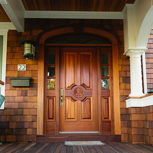 Inspiration for a mid-sized beach style dark wood floor entryway remodel in Providence with a brown front door and brown walls