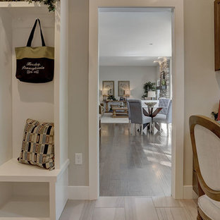 Entryway - large traditional ceramic tile and beige floor entryway idea in Other with beige walls