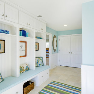 Example of a coastal entryway design in Other with blue walls and a white front door