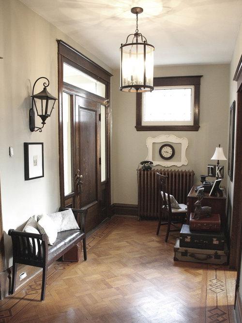 Eclectic Medium Tone Wood Floor Single Front Door Photo In Toronto With A  Dark Wood Front