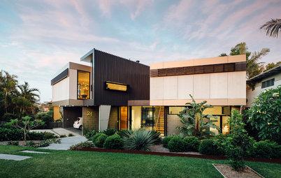 大きな屋根つきデッキで心地よく外につながる家