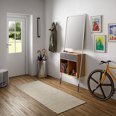 Example of a mid-sized danish light wood floor foyer design in Venice with white walls