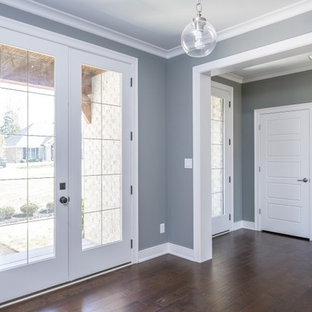 Mid-sized transitional vinyl floor entryway photo in Louisville with blue walls and a white front door
