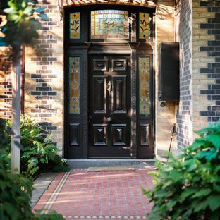 This is an example of a transitional front door in Melbourne with a single front door and a black front door.