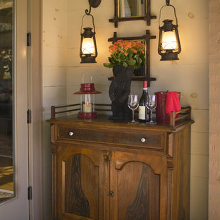 Entryway - mid-sized rustic dark wood floor entryway idea in Other with white walls and a white front door