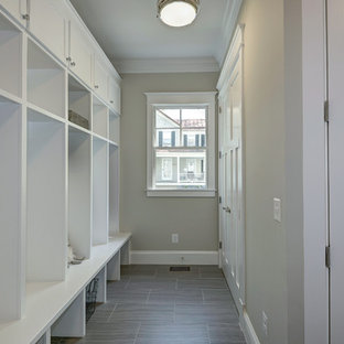 Example of a large minimalist linoleum floor mudroom design in DC Metro with gray walls