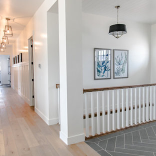 Example of a mid-sized cottage porcelain tile and black floor entryway design in Salt Lake City with white walls and a black front door