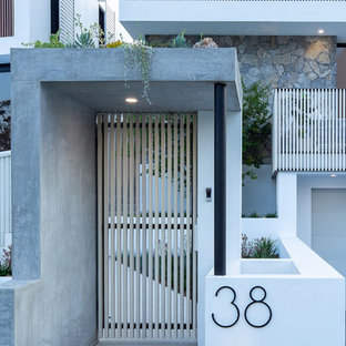 Small contemporary entryway in Brisbane with white walls, concrete floors and grey floor.