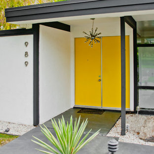 Example of a 1950s entryway design in Los Angeles with a yellow front door