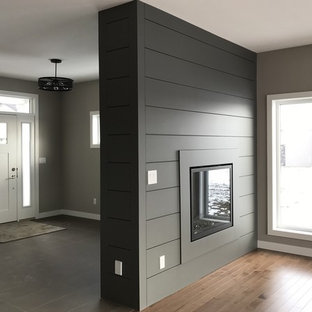 Entryway - large craftsman porcelain floor entryway idea in Other with gray walls and a white front door