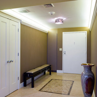 Entryway - large transitional travertine floor entryway idea in Philadelphia with brown walls and a white front door