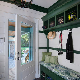 Entryway - cottage black floor entryway idea in Other with white walls and a white front door